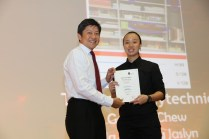 MIN presenting the Merit Award certificate to Jacqueline Quek Jia Ling (Merit Award Winner from Temasek Polytechnic) for her 'Show me true colour' invention – which helps the colour blind identify colours in daily life.