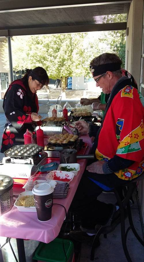 Tomomi Katz on left working at her takoyqki food booth, photo credit Brandy Gannon