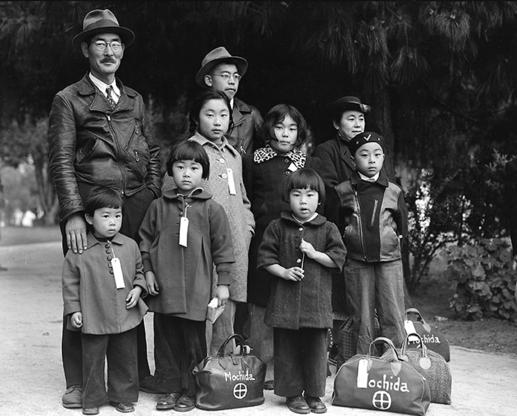 Hayward, California, May 8,1942. Members of the Mochida family awaiting evacuation bus. Photographer: Dorothea Lange