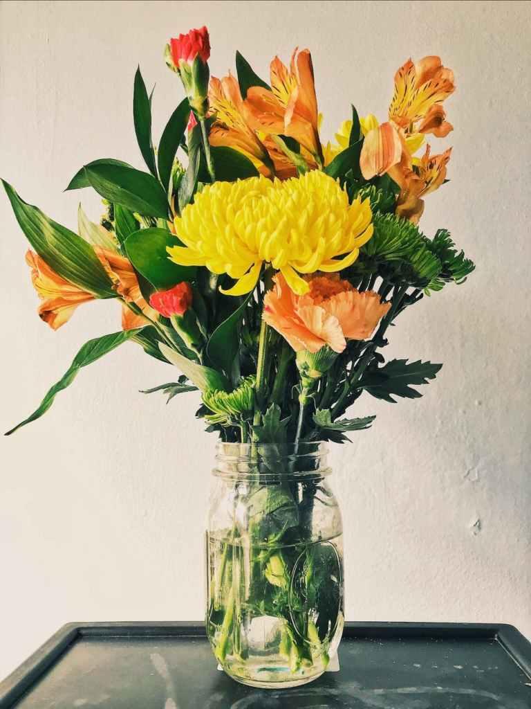 Ikeban art of flower arrangement yellow mums orange peruvian lilies and carnation flower arrangement