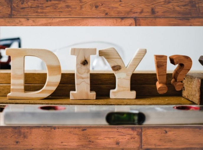 """wooden grain background, photo with wooden letters """"DIY !?"""""""
