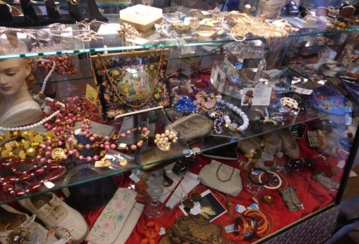 A glass case filled with jewelry and other accessories at Personas