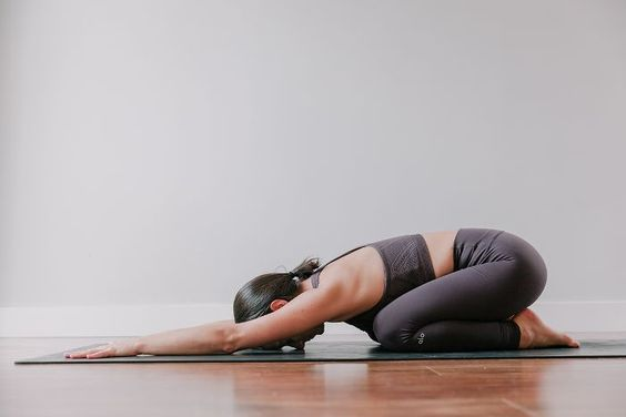 Try These Yoga Poses To Sleep Better Tonight
