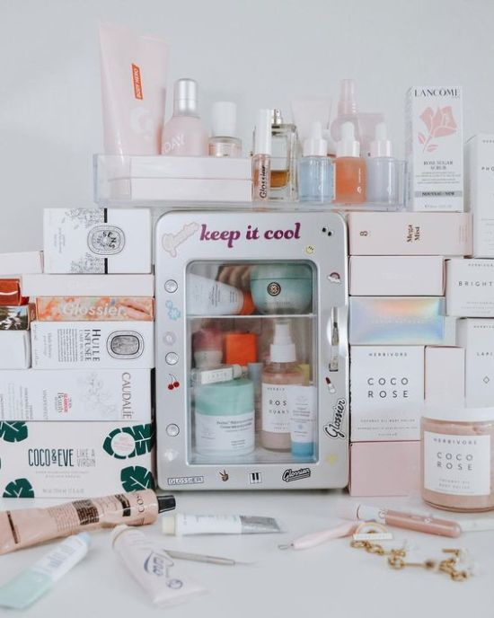 """The best word to describe the current climate of the skincare industry is """"extra"""" - wonderfully extra. We are living in the self-care era where jade rollers, gold face masks, and CBD serums are all the rage. Recently technology and beauty merged, gifting us with 2019's biggest skincare trend, beauty fridges. Danity, brightly colored mini fridges have become the most extra skincare trend yet, with tons of bloggers and beauty addicts jumping on board. So, why do you need one and where do you find one?These tiny fridges are compact enough to fit on your bathroom vanity but big enough to house your daily routine. You can store jade rollers, eye creams, sheet masks, and serums - whatever you'd like. You're probably asking yourself 'why?' Turns out some beauty products are best served cold - especially your favorite organic products. Organic skincare is usually formulated without preservatives, and keeping them in the fridge could help extend their longevity. Everyone's favorite Fresh Facemasks from Lush need to be kept cold in order to preserve the benefits of their natural ingredients. You might be surprised to learn that sunscreens should be stored in a cold area to ensure the SPF's quality. Most of us keep the bulk of our beauty products in our bathrooms but the heat and humidity of the shower can actually allow for the growth of bacteria. Not to mention, keeping your products in the fridge will make your routine feel even more refreshing. Everyone knows a cold compress is great for inflammation, that's why our grandmothers kept spoons in the freezer.Frigidaire's retro mini fridge has become a cult favorite beauty fridge - though it's not marketed as such. Not only is it ridiculously adorable but it's also very functional and spacious. It comes in baby pink, turquoise, red, and black. Currently, this it's being sold at Walmart, Amazon, and Frigidaire for 35 dollars. With hundreds of 5-star reviews and the beauty guru mark of approval, Frigidaire's mini is currently th"""