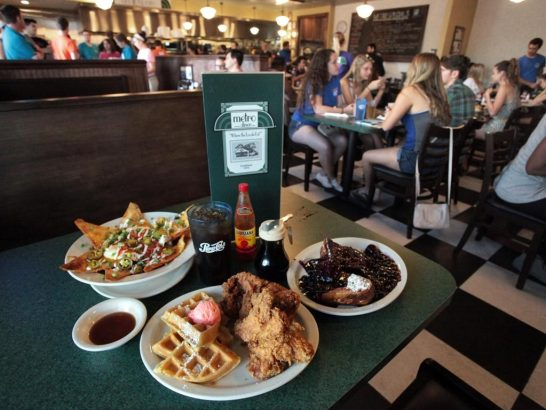 Inside Gainesville's Metro Diner location with food on the table and people eating in the background