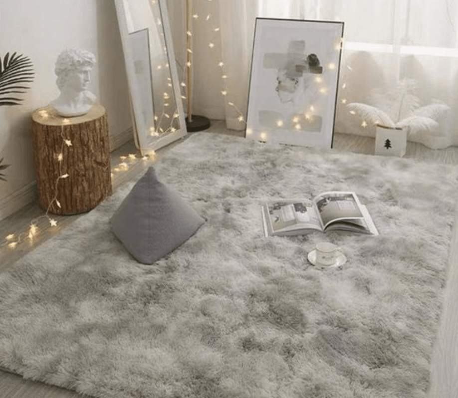 A fuzzy rug that is perfect for warming up the vibe of a dorm room