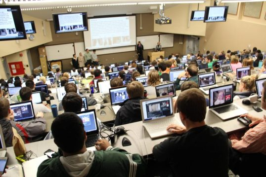Students using laptops in a lecture in college