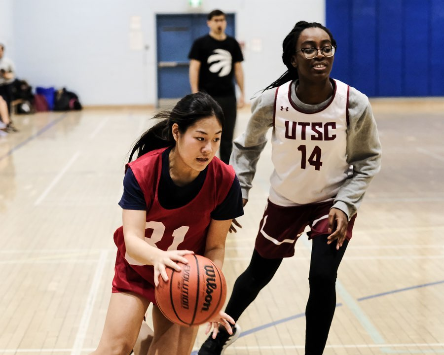 fitness tips: two girls playing basketball
