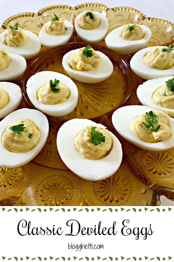 Classic Deviled Eggs are a must-have at most holidays, Easter, potlucks, and other gatherings. With just 5 main ingredients to the filling, deviled eggs are easy and quick to make. #deviledeggs #eggs