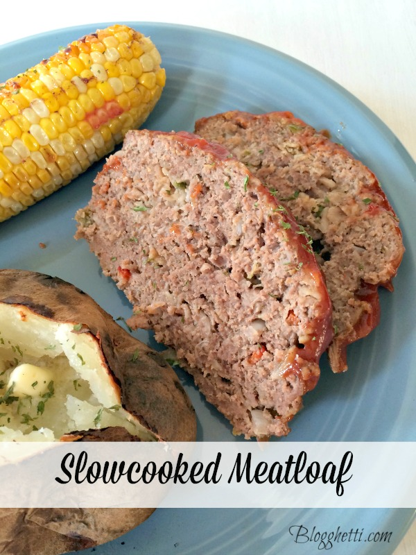 slow cooked meatloaf on a blue dinner plate with corn and baked potato