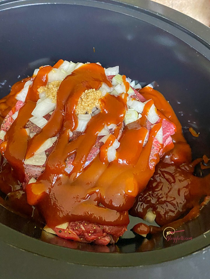 roast with bbq sauce ready to slow cook