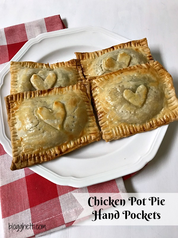 Think of these individual Chicken Pot Pie Hand Pockets as comfort food to go. Handheld pies filled with a creamy chicken pot pie mixture puts dinner on the table in 30 minutes. Perfect for lunches on the go or a fast dinner for busy nights.