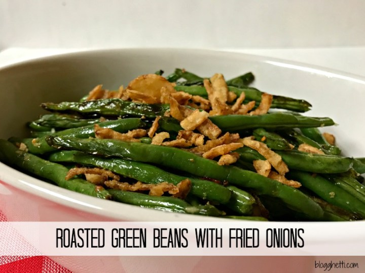 Roasting Green Beans with garlic and a bit of olive oil takes the vegetable to a whole new level and when topped with crunchy fried onions, they are the perfect side dish for any meal.