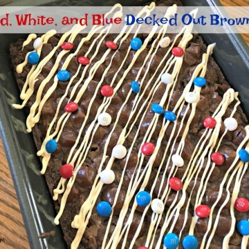 Red, White, and Blue Decked Out Brownies are the perfect patriotic summer treat Fudgy brownies filled with chocolate and M & M candies topped with marshmallows, more candy and drizzled with white chocolate.