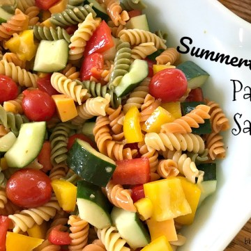 This Summertime Pasta Salad is colorful, fresh and full of flavor from all of the vegetables and the zesty dressing. Not to mention, it's quick to make and is perfect for your next picnic or cookout.