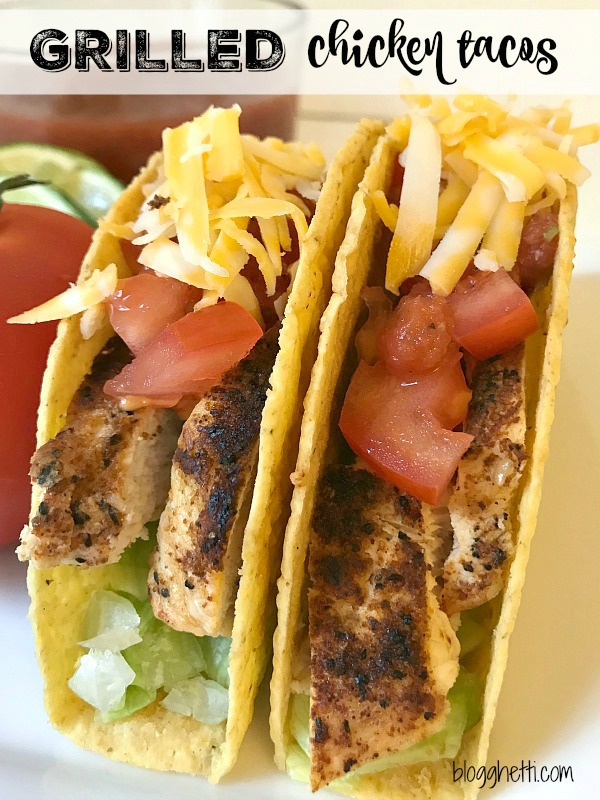 Two Grilled Chicken Tacos with cheese, lettuce, and tomatoes