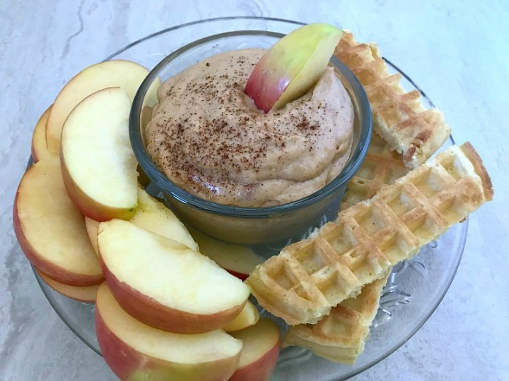 Cinnamon Peanut Butter Dip is simple to make and a delicious sweet treat for fruit and more. Simple ingredients that you probably already have in the pantry go into making this 5 minute dip. #peanutbutter #dip #fruit #nationalpeanutbutterday