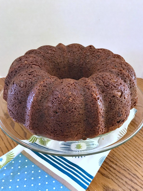 This German Chocolate Bundt Cake with a Homemade Coconut Frosting is moist, decadent, and does not disappoint. Perfect cake to celebrate any special occasion. #GermanChocolateCake #cake #chocolate