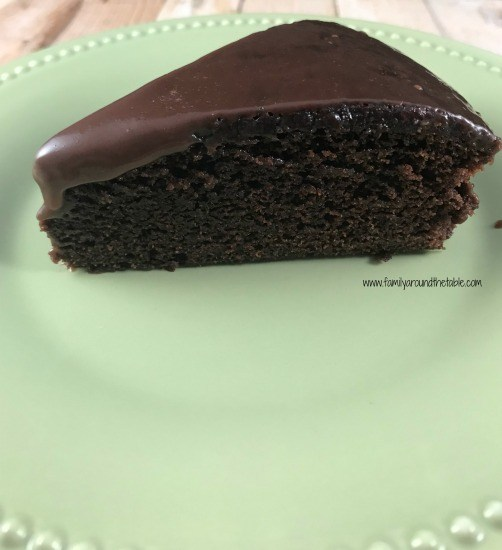slice of double chocolate cake on a plate