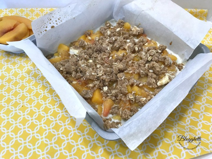 Peach Streusel Crumb Bars ready to be baked