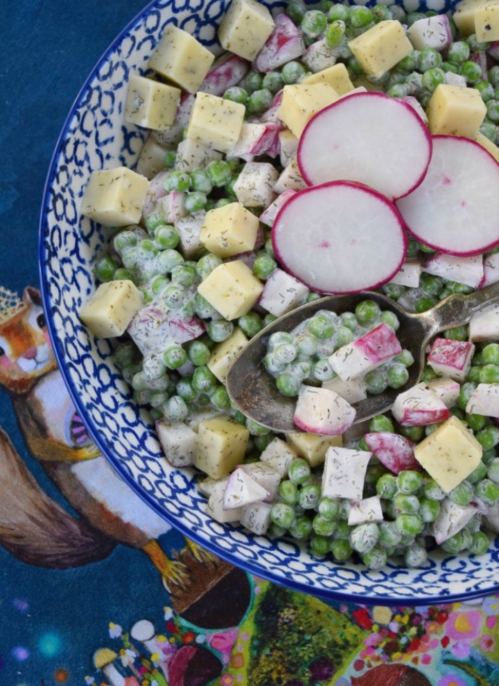 Baby Sweet Pea & Radish Salad on a blue and white plate