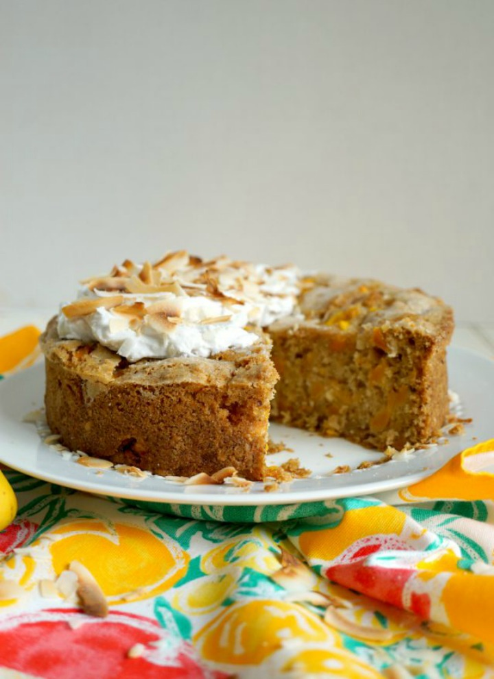 vegan mango coconut snack cake on cake plate