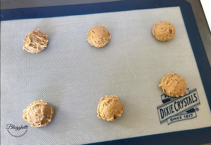 Pumpkin Cookie dough balls on sheet pan ready to bake