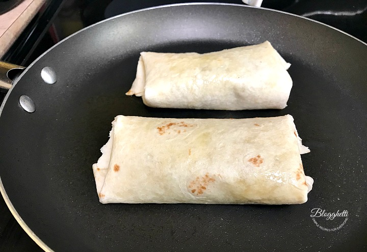 Preparing the wraps with southwestern filling