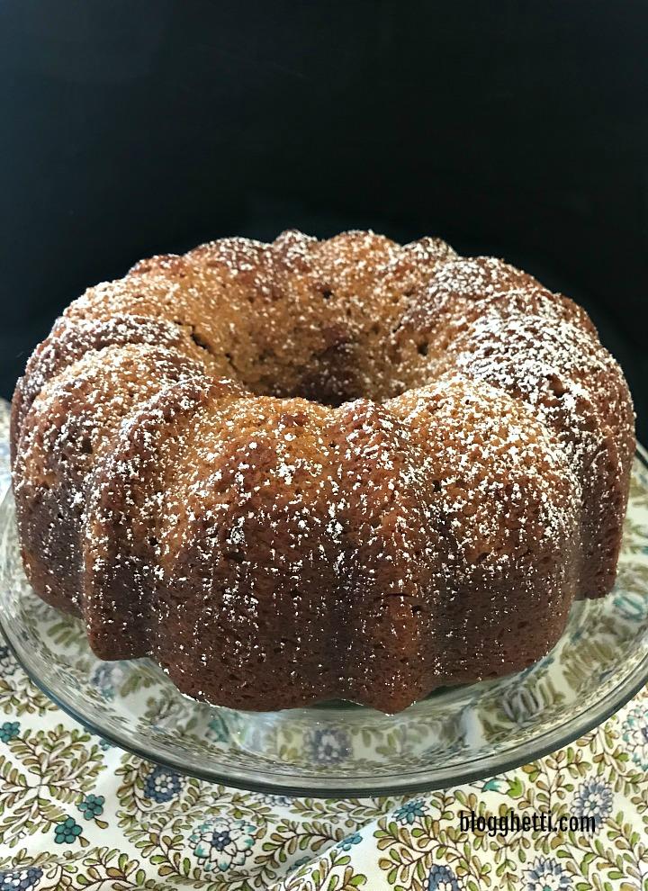 apple butter bundt cake on cake stand