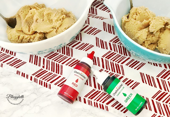 cookie dough divided into two portions to be colored with red and green oils