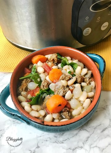 bowl of Tuscan White Bean Soup with Sausage made in the slow cooker