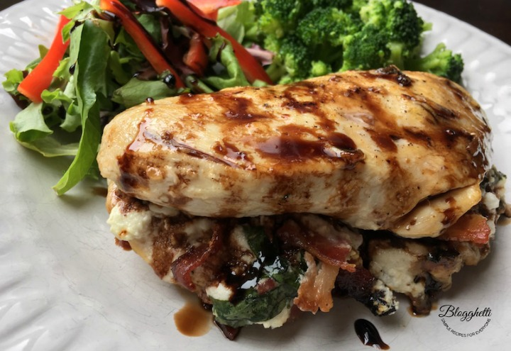Bacon, Goat Cheese & Basil Stuffed Chicken Breasts with Balsamic Glaze on white plate with veggies