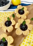 Blueberry flower tarts with mint leaf for garnish