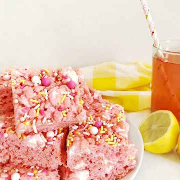 Pink Lemonade Rice Krispie Treats cut into squares on plate