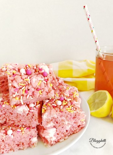 Pink Lemonade Rice Krispie Treats cut into squares on plate