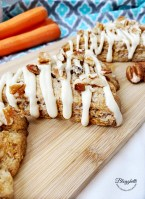 close up of carrot cake scones with fresh carrots in the background
