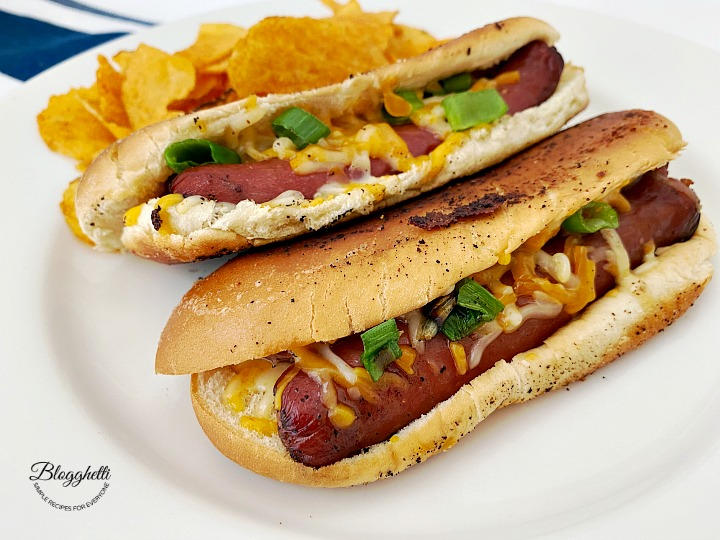 easy grilled cheese hot dogs on white plate