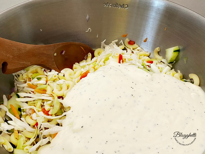 Mixing the Macaroni Coleslaw Salad in large bowl