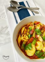 white bowl filled with Vegetablr Tortellini Soup