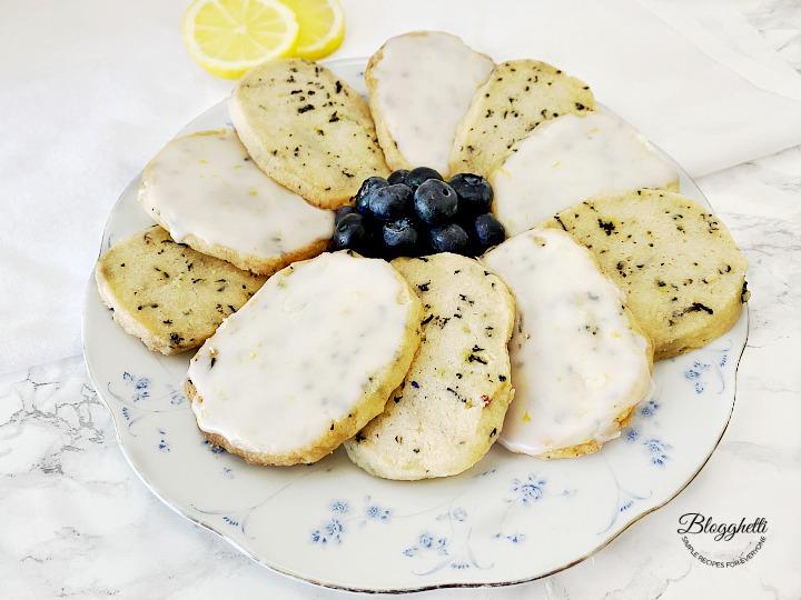 Plate of Blueberry Earl Grey Shortbread Cookies with Lemon Glaze