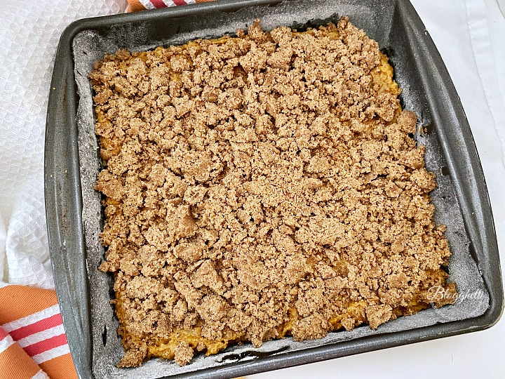Pumpkin Spice Coffee Cake batter with streusel topping ready to bake