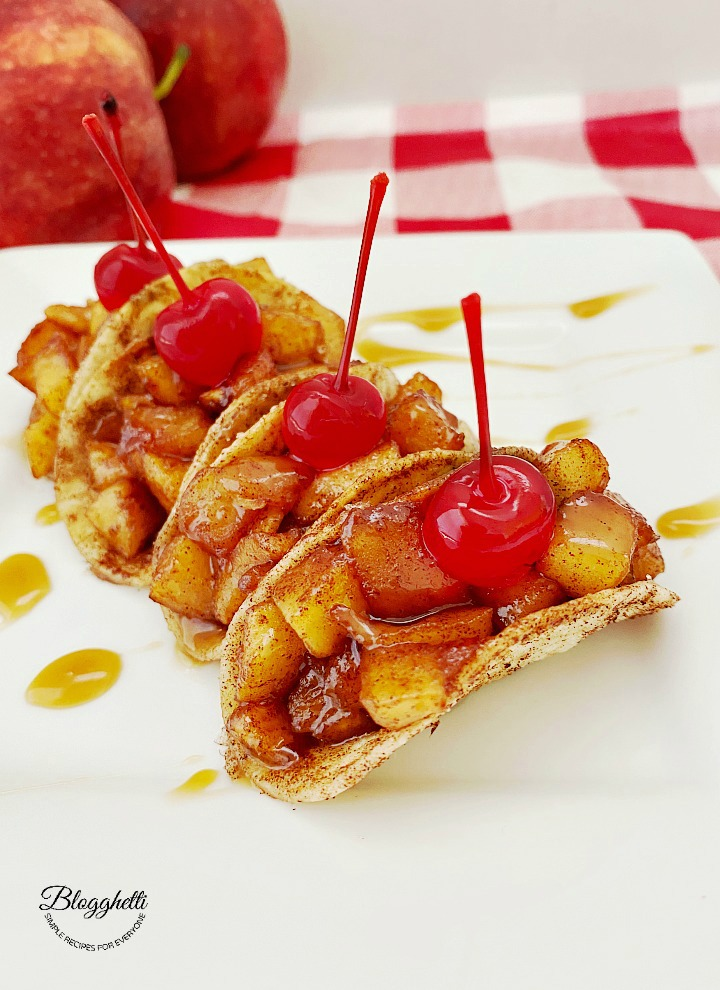 apple pie tacos with maraschino cherries on top