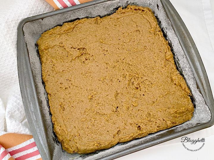 pumpkin spice coffee cake batter in baking pan