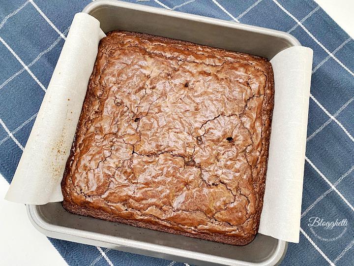 triple chunk chocolate brownies cooling in baking pan