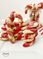 Candy Cane cookies stacked on white plate