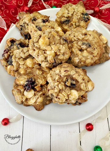 Plate of cranberry pecan oatmeal cookies with holiday decor
