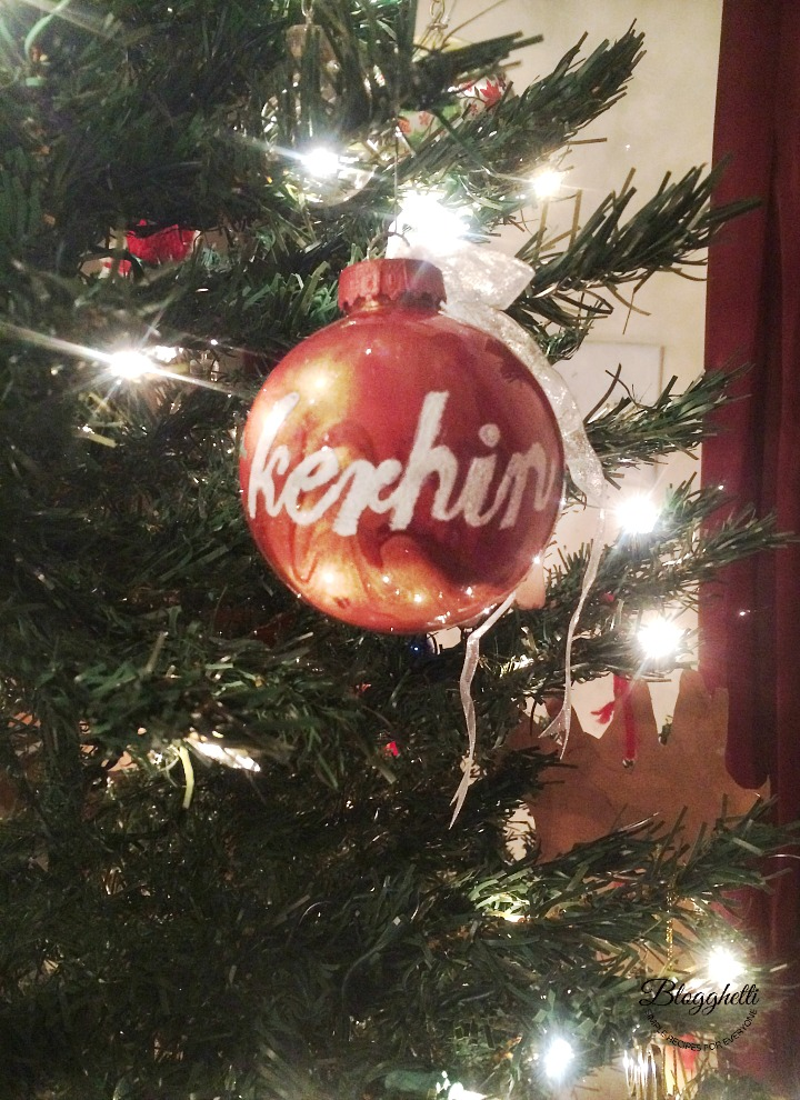 Pour Painted Ornament hanging on Christmas tree