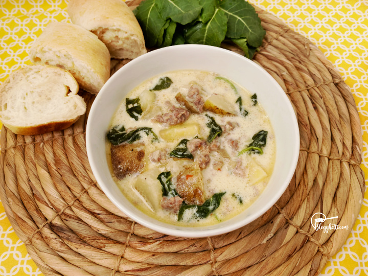 bowl of slow cooker zuppa toscana soup with bread