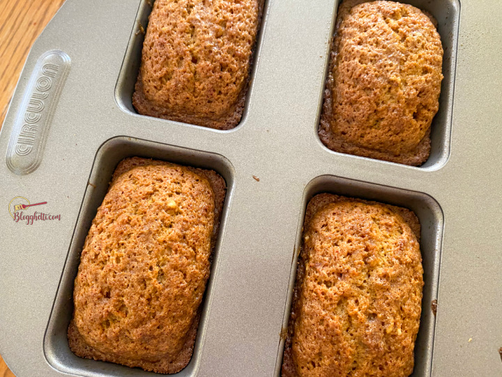 Baked mini loaves of carrot cake cooling in pan