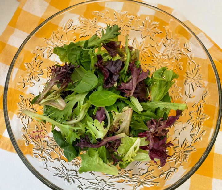 crystal salad bowl with spring greens